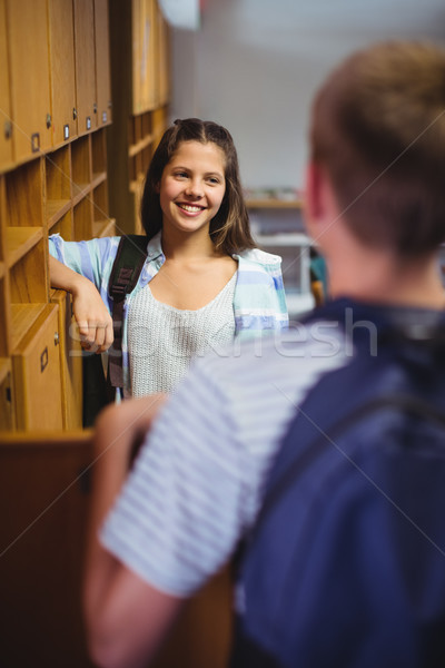 Happy students interacting with each other in locker room Stock photo © wavebreak_media