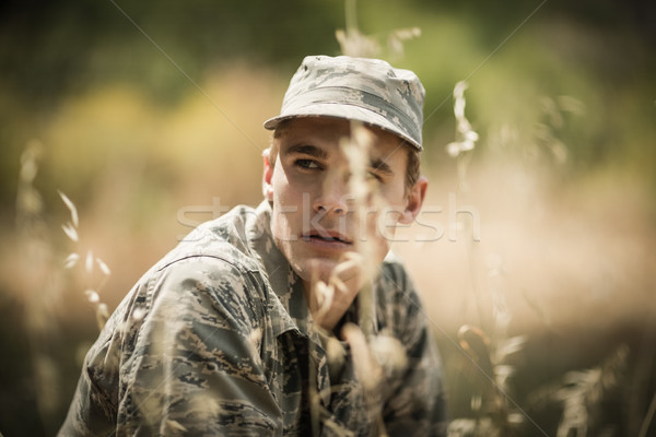 Thoughtful military soldier relaxing in grass  Stock photo © wavebreak_media