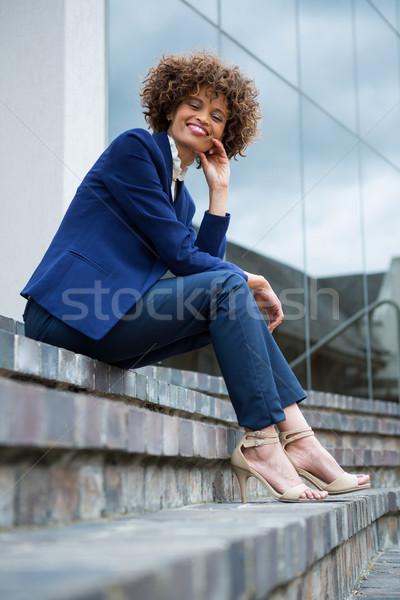 Smiling businesswoman sitting in the premises Stock photo © wavebreak_media