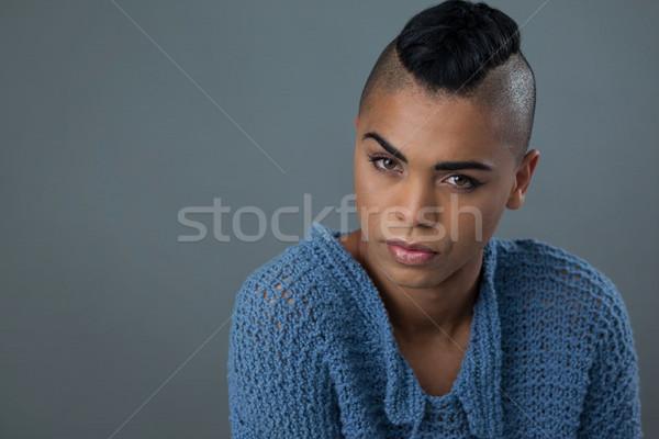 Transgender vrouw Blauw trui grijs Stockfoto © wavebreak_media