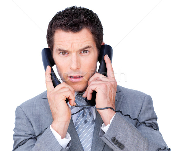 Upset businessman tangle up in phone wires Stock photo © wavebreak_media