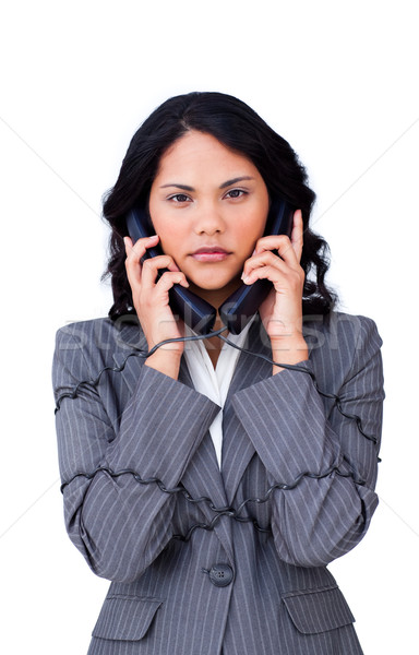 Stressed businesswoman tangled up in phone wires  Stock photo © wavebreak_media