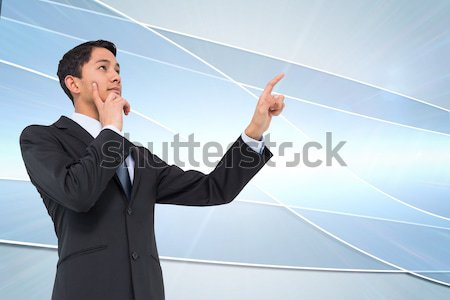 Successful businessman punching the air in celebration Stock photo © wavebreak_media