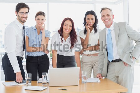 Assertive manager with folded arms in front of her team  Stock photo © wavebreak_media