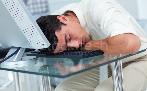 Tired businessman sleeping at his desk Stock photo © wavebreak_media