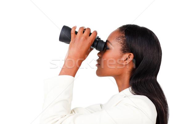 Charismatic businesswoman looking to the future through binocula Stock photo © wavebreak_media
