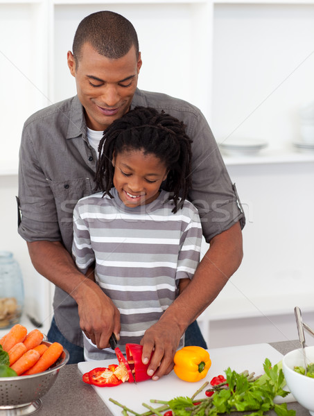 Attentive father helping his son cut vegetables Stock photo © wavebreak_media