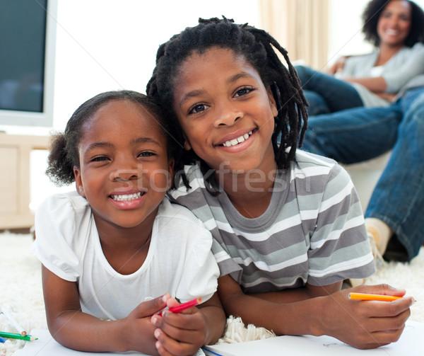 Boldog testvérek rajz padló szülők család Stock fotó © wavebreak_media