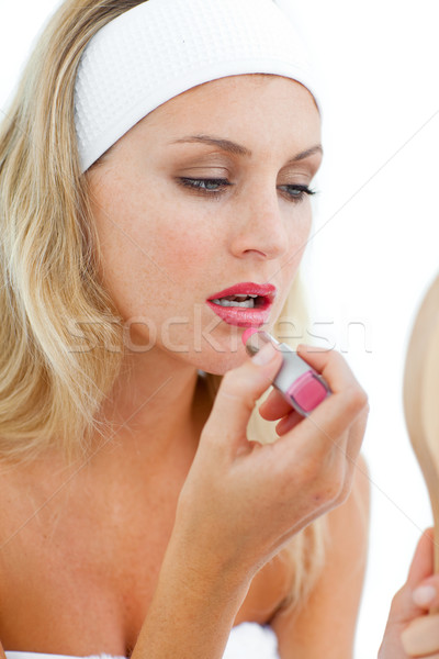 Concentrated woman applying lipstick  Stock photo © wavebreak_media