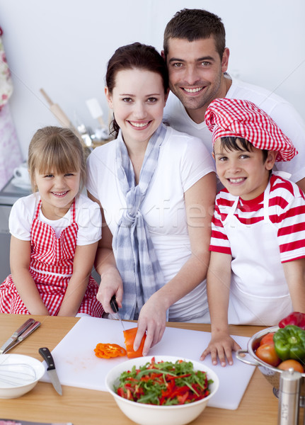 Young family cutting vegetables in kitchen Stock photo © wavebreak_media