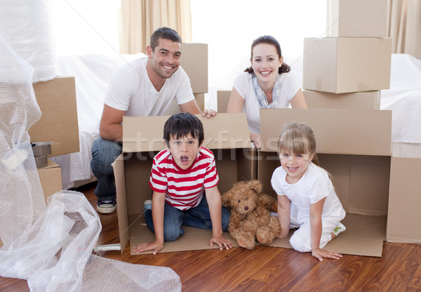 Family moving house with boxes around Stock photo © wavebreak_media