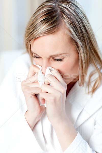 Sick woman blowing  Stock photo © wavebreak_media