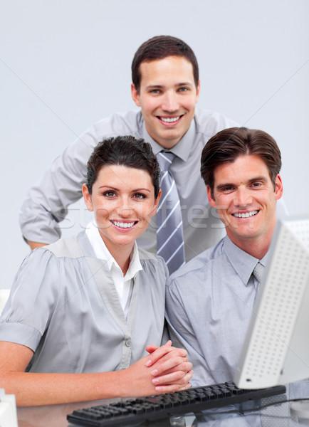 Fortunate businessteam working at a computer Stock photo © wavebreak_media