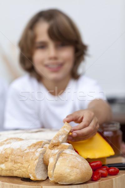 Close-up of child's hand taking bread Stock photo © wavebreak_media