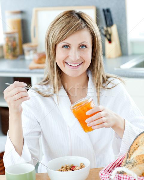 Young woman having breakfast in the kitchen Stock photo © wavebreak_media