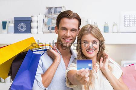 Smiling woman giving a present to her boyfriend in the living-room Stock photo © wavebreak_media
