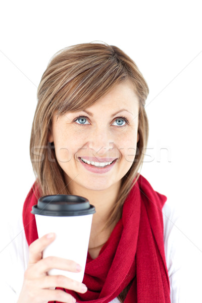 Positive woman holding a coffee wearing a scarf against white background Stock photo © wavebreak_media