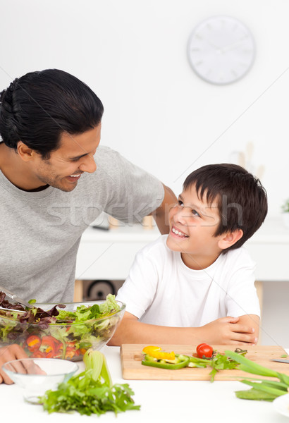 Happy father helping his son in the kitchen at home Stock photo © wavebreak_media