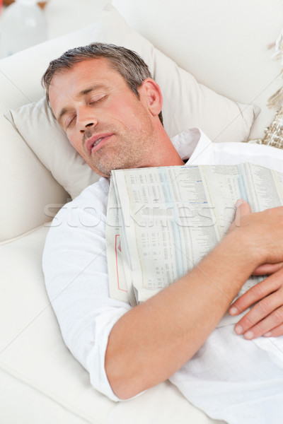 Exhausted man sleeping on the couch at home Stock photo © wavebreak_media