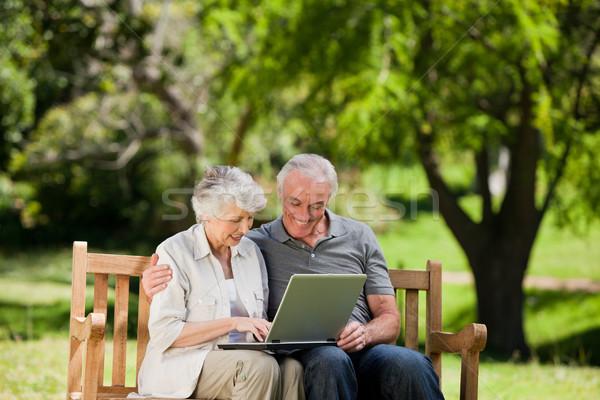 Elderly couple looking at their laptop Stock photo © wavebreak_media