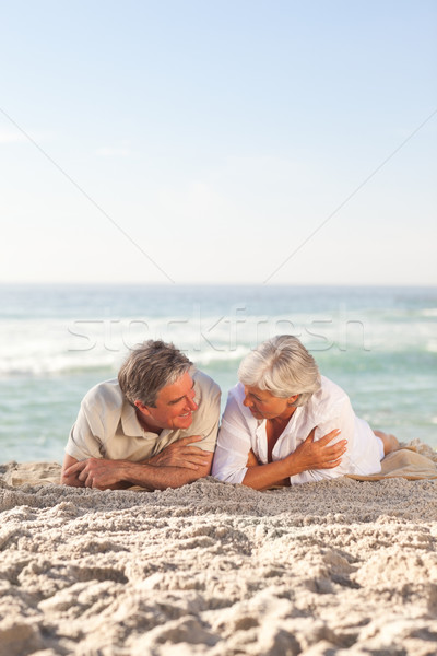 Mature couple lying down on the beach Stock photo © wavebreak_media