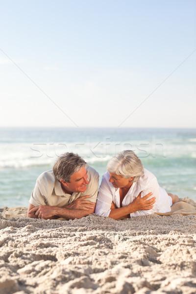 Maturité couple couché plage heureux marche Photo stock © wavebreak_media