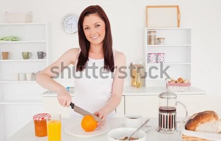 Glimlachend blonde vrouw ontbijt keuken vrouw mode Stockfoto © wavebreak_media