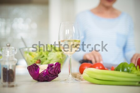 Cute Woman eating lunch and drinking wine in a kitchen Stock photo © wavebreak_media