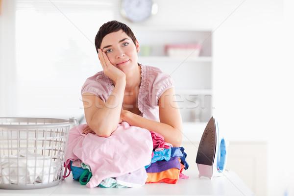 Unatkozik nő köteg ruházat hasznosság szoba Stock fotó © wavebreak_media