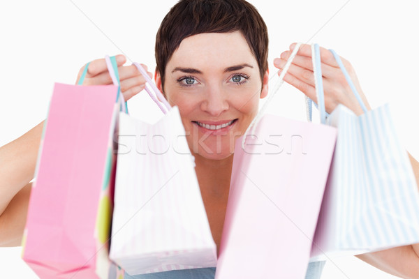 Woman with shopping bags against a white background Stock photo © wavebreak_media