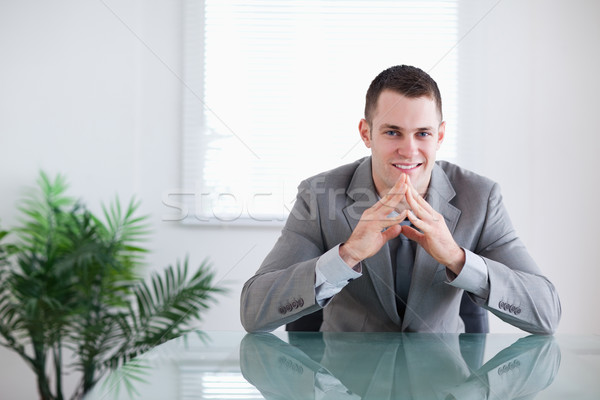 Young businessman getting good news sitting behind a table Stock photo © wavebreak_media