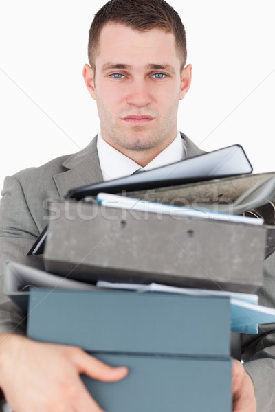 Portrait of a overwhelmed young businessman against a white background Stock photo © wavebreak_media