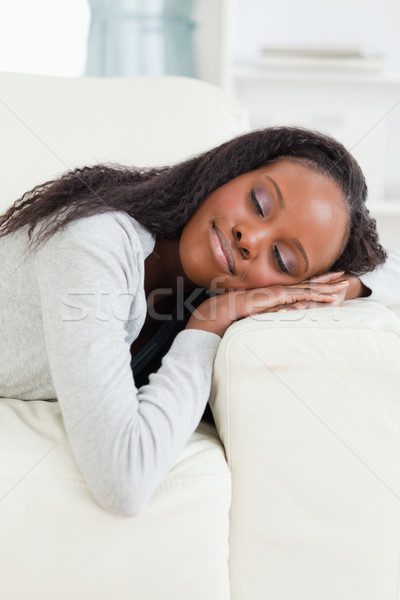 Young woman lying on the sofa with eyes closed Stock photo © wavebreak_media