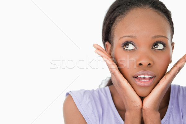 Close up of young woman being afraid on white background Stock photo © wavebreak_media