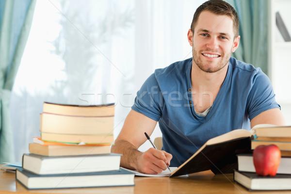 Mosolyog férfi diák teszt papír iskola Stock fotó © wavebreak_media