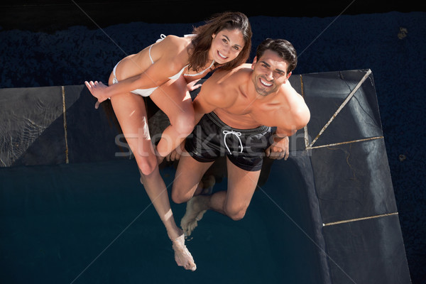 Above view of a smiling couple posing in a swimming pool Stock photo © wavebreak_media