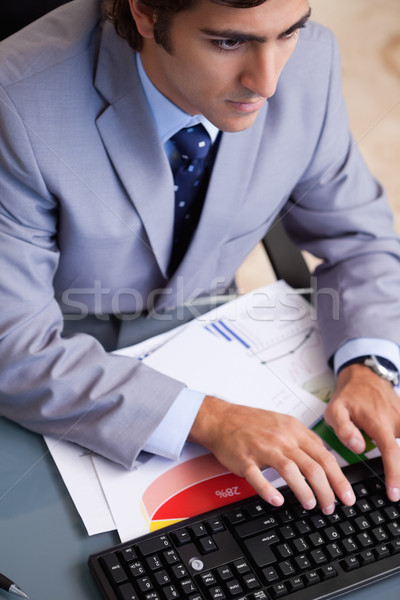 Above view of young businessman typing Stock photo © wavebreak_media