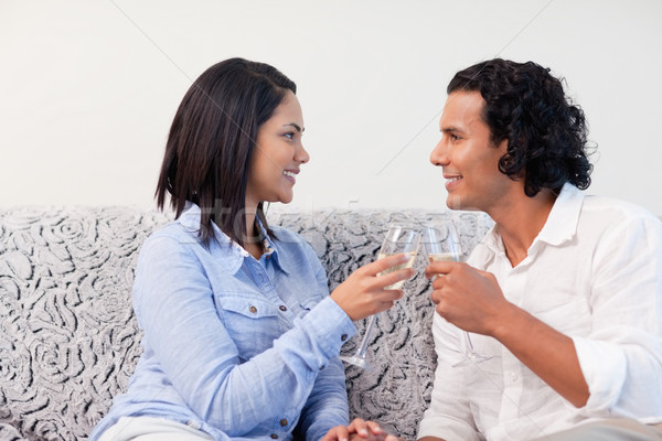 Young couple having sparkling wine on the sofa Stock photo © wavebreak_media