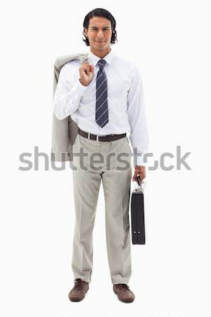 Portrait of an office worker holding his jacket over his shoulder and a briefcase against a white ba Stock photo © wavebreak_media