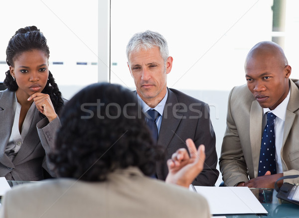 Business people attentively listening to a serious speaker in a meeting Stock photo © wavebreak_media