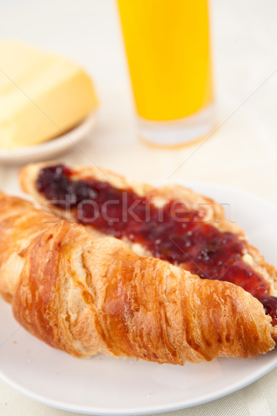 Croissant in front of a glass of orange juice on a table Stock photo © wavebreak_media