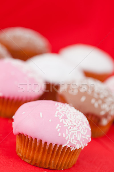 Many muffins with icing sugar on a red tablecloth  Stock photo © wavebreak_media