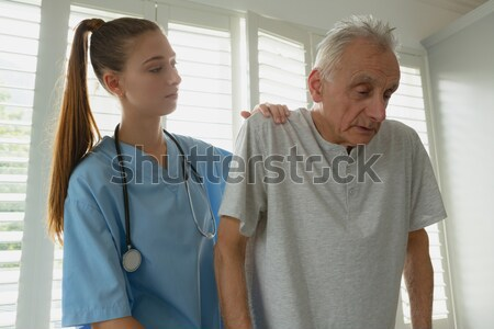 Nurse and a patient standing in hospital ward Stock photo © wavebreak_media