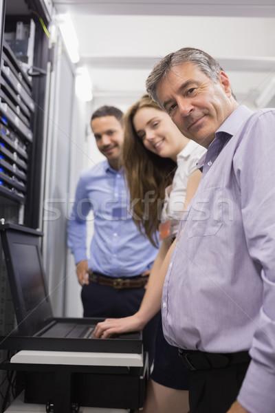 Három boldog szerverek laptop adatközpont számítógép Stock fotó © wavebreak_media