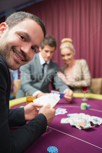 Adam gülen oturma poker tablo kumarhane Stok fotoğraf © wavebreak_media