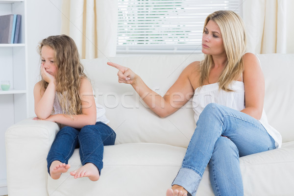 Angry mother scolding her daughter Stock photo © wavebreak_media