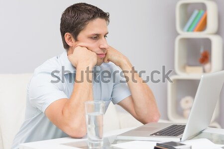 Frustrated business woman with head in hands in front of laptop  Stock photo © wavebreak_media
