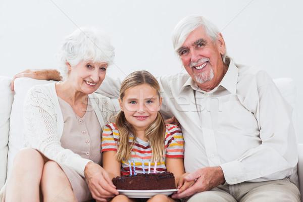 девочку рождения дедушка и бабушка торт диване Сток-фото © wavebreak_media