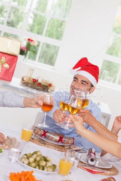 Stock photo: Family toasting at Christmas
