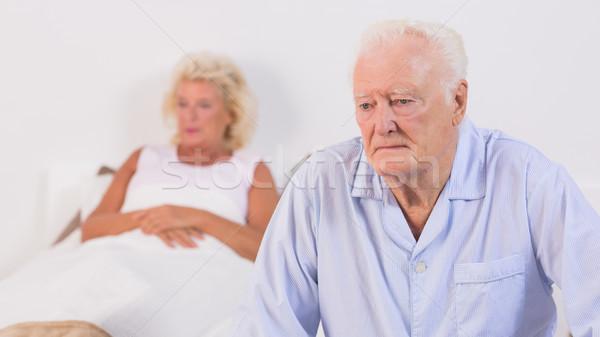 Stock photo: Unsmiling aged couple